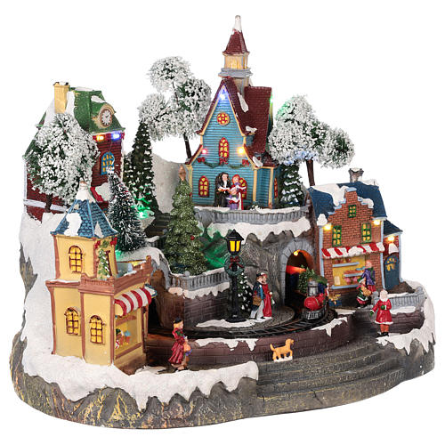 Christmas village with shops, moving elements, lights and music 35x45x35 cm 4