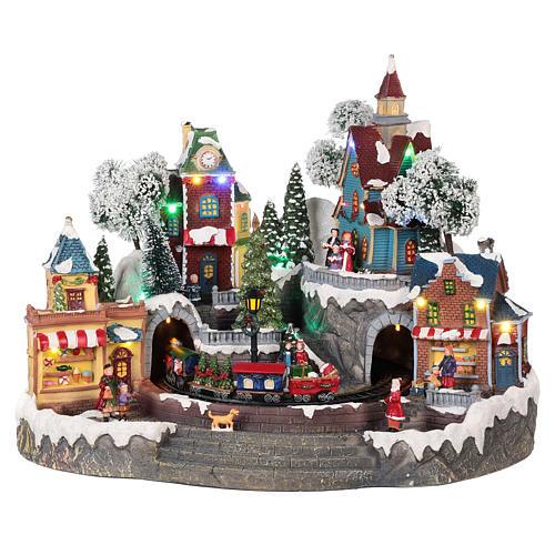 Pueblo navideño tren y tiendas movimiento luz música 35x45x35 1