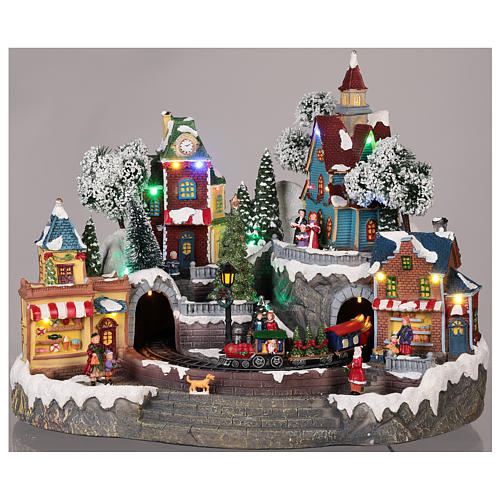 Pueblo navideño tren y tiendas movimiento luz música 35x45x35 2