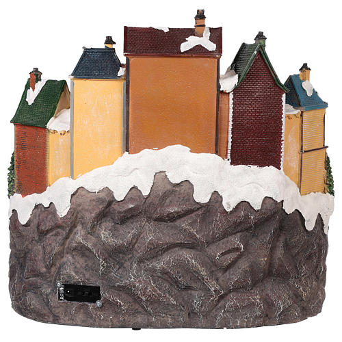 Christmas village with moving elements, lights and music 40x40x35 cm 5