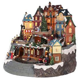 Village Noël ville et train mouvement lumière musique 40x40x35 cm s3