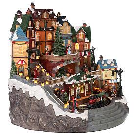 Village Noël ville et train mouvement lumière musique 40x40x35 cm s4