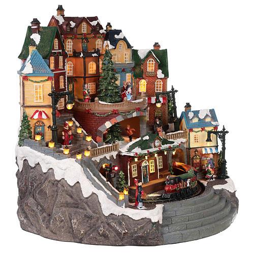 Village Noël ville et train mouvement lumière musique 40x40x35 cm 4