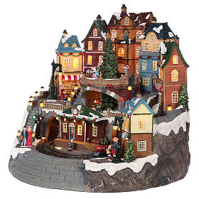 Villaggio natalizio cittadina e trenino movimento luce musica 40x40x35 s3