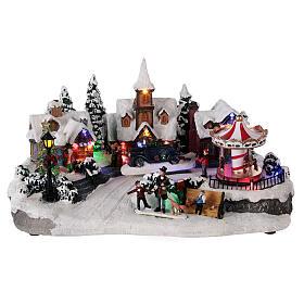 Pueblo invernal coche en movimiento música y luces 40x25x20 cm s1