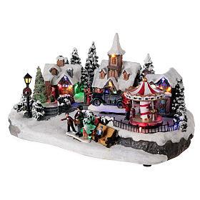 Pueblo invernal coche en movimiento música y luces 40x25x20 cm s3