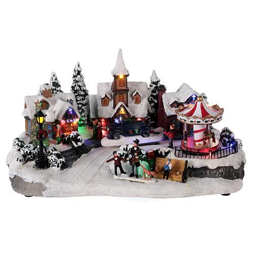 Pueblo invernal coche en movimiento música y luces 40x25x20 cm 1