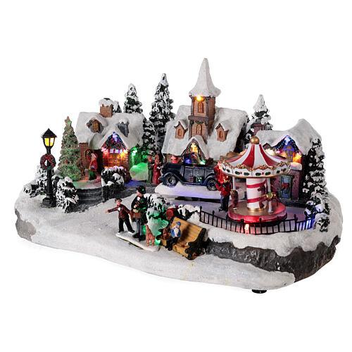 Pueblo invernal coche en movimiento música y luces 40x25x20 cm 3