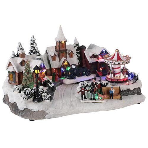 Pueblo invernal coche en movimiento música y luces 40x25x20 cm 4