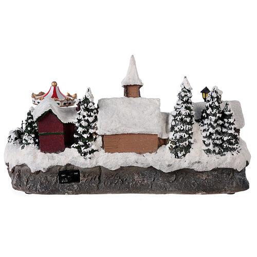 Pueblo invernal coche en movimiento música y luces 40x25x20 cm 5