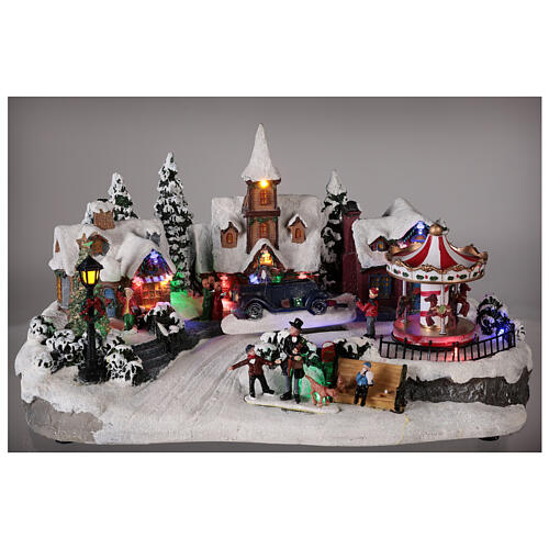 Christmas village with moving car music and lights 40x25x20 cm 2