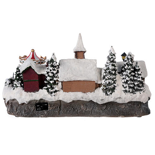 Christmas village with moving car music and lights 40x25x20 cm 5