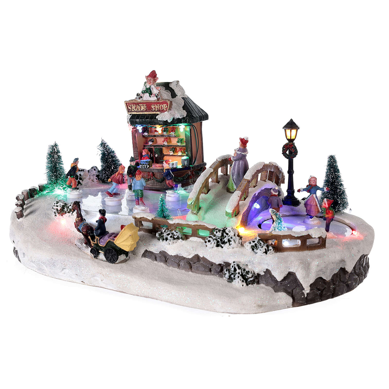 Village de Noël miniature patinage avec magasin 25x20x40 cm 3