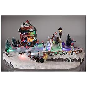 Village de Noël miniature patinage avec magasin 25x20x40 cm s2