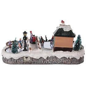 Village de Noël miniature patinage avec magasin 25x20x40 cm s5