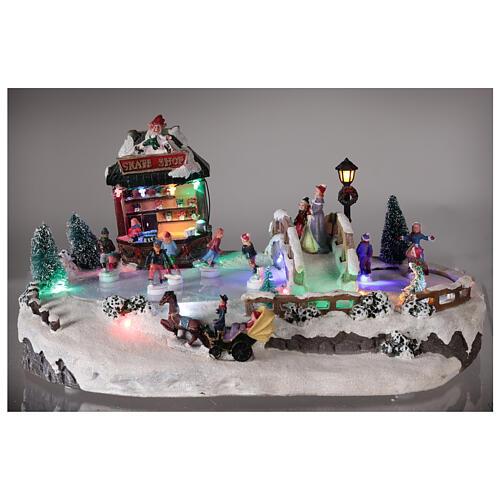 Village de Noël miniature patinage avec magasin 25x20x40 cm 2