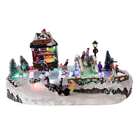 Christmas village with ice rink and shop, 25x20x40 cm s1