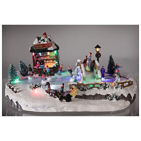 Christmas village with ice rink and shop, 25x20x40 cm s2