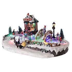 Christmas village with ice rink and shop, 25x20x40 cm s3