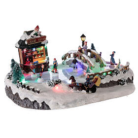 Christmas village with ice rink and shop, 25x20x40 cm s4