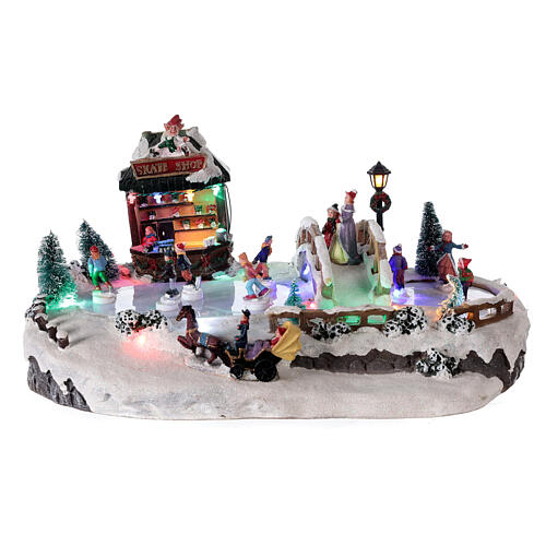 Christmas village with ice rink and shop, 25x20x40 cm 1