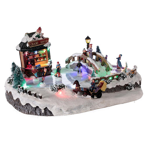 Christmas village with ice rink and shop, 25x20x40 cm 4