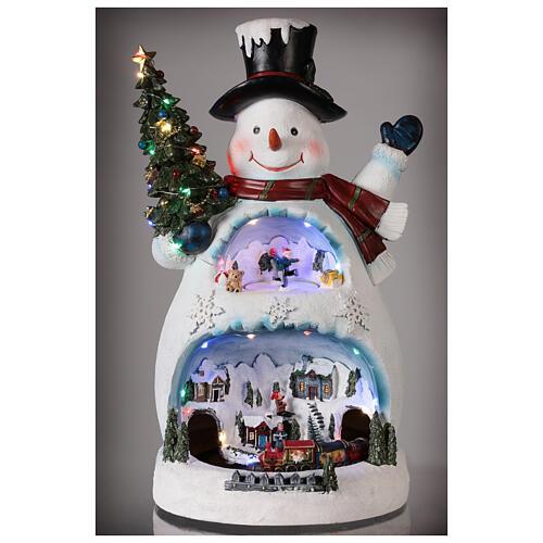 Bonhomme de neige Noël piste patinage et train 45x20x25 cm 2