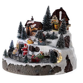 Village avec Père Noël musique et lumières 25x25 cm s3