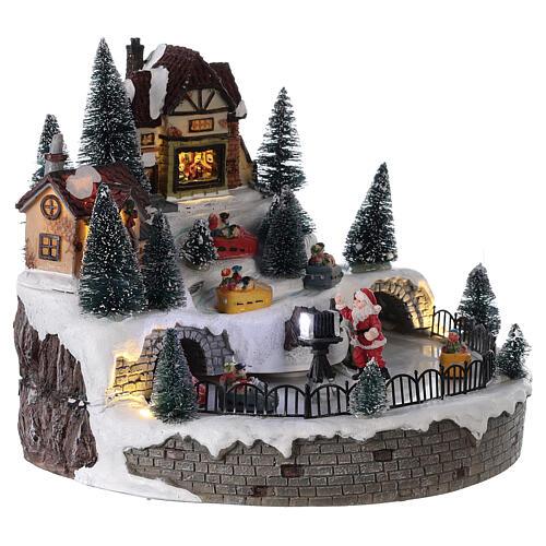 Village avec Père Noël musique et lumières 25x25 cm 4