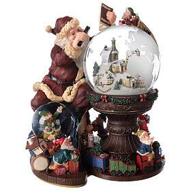 Boîte à musique et boule à neige Père Noël mappemonde 25x25x20 cm s1