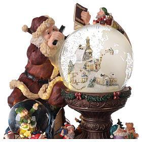Boîte à musique et boule à neige Père Noël mappemonde 25x25x20 cm s2