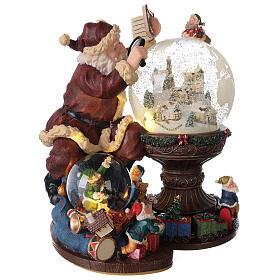 Boîte à musique et boule à neige Père Noël mappemonde 25x25x20 cm s5