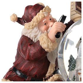 Boîte à musique et boule à neige Père Noël mappemonde 25x25x20 cm s6