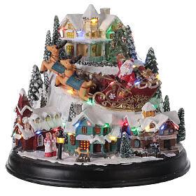 Aldeia de Natal em miniatura com árvore, Pai Natal no trenó, luzes e música, 24,5x28x24 cm s1