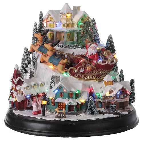 Aldeia de Natal em miniatura com árvore, Pai Natal no trenó, luzes e música, 24,5x28x24 cm 1