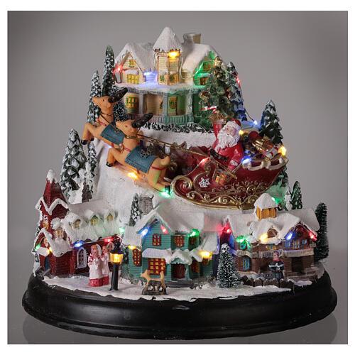 Aldeia de Natal em miniatura com árvore, Pai Natal no trenó, luzes e música, 24,5x28x24 cm 2