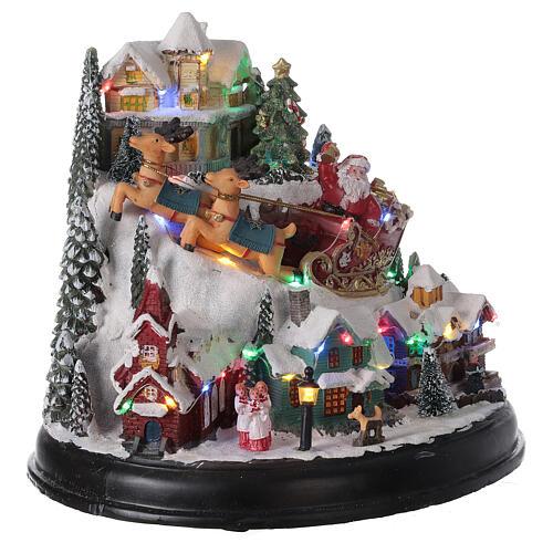 Aldeia de Natal em miniatura com árvore, Pai Natal no trenó, luzes e música, 24,5x28x24 cm 4