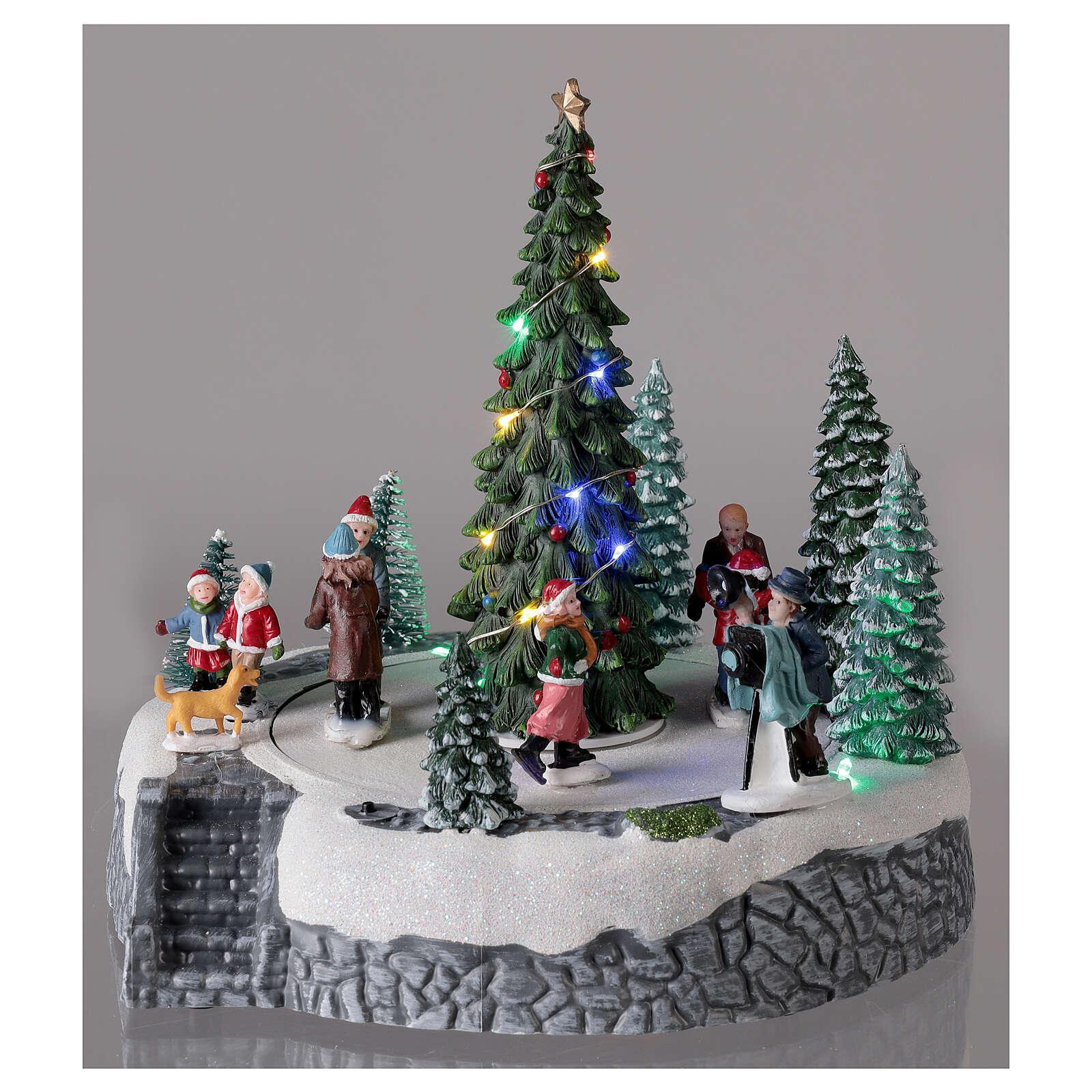Lighted Christmas village ice skaters tree LED music 25x20x20 cm 3