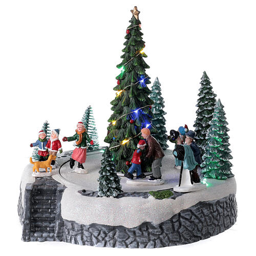 Lighted Christmas village ice skaters tree LED music 25x20x20 cm 1