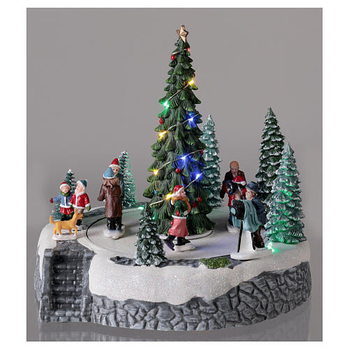 Lighted Christmas village ice skaters tree LED music 25x20x20 cm 2