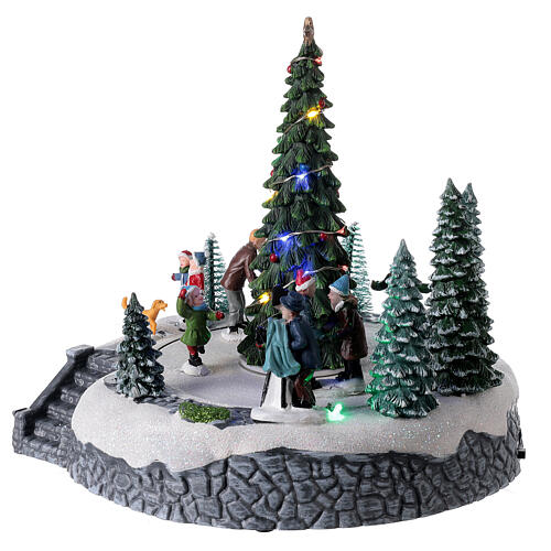 Lighted Christmas village ice skaters tree LED music 25x20x20 cm 3