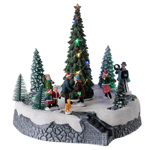 Lighted Christmas village ice skaters tree LED music 25x20x20 cm 4