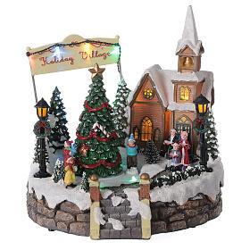 Villaggio Natale luminoso chiesa cori pattinatori musica 20x25x25 cm s1
