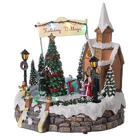Villaggio Natale luminoso chiesa cori pattinatori musica 20x25x25 cm s4