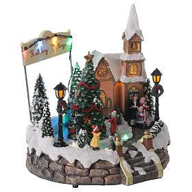 Villaggio Natale luminoso chiesa cori pattinatori musica 20x25x25 cm s5
