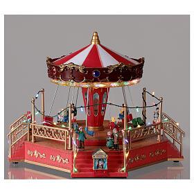 Christmas swing carousel village lights music 25x35x30 cm s2