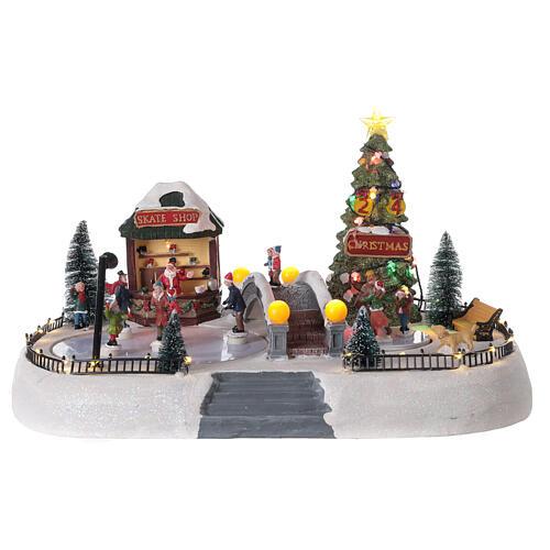 Christmas village ice skaters LED lights music 35x45x30 cm 1