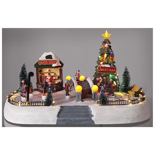 Christmas village ice skaters LED lights music 35x45x30 cm 2