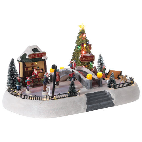 Christmas village ice skaters LED lights music 35x45x30 cm 4