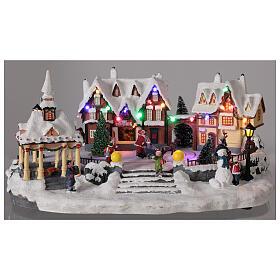 Villaggio natalizio innevato piazza led musica 25x45x30 cm s2